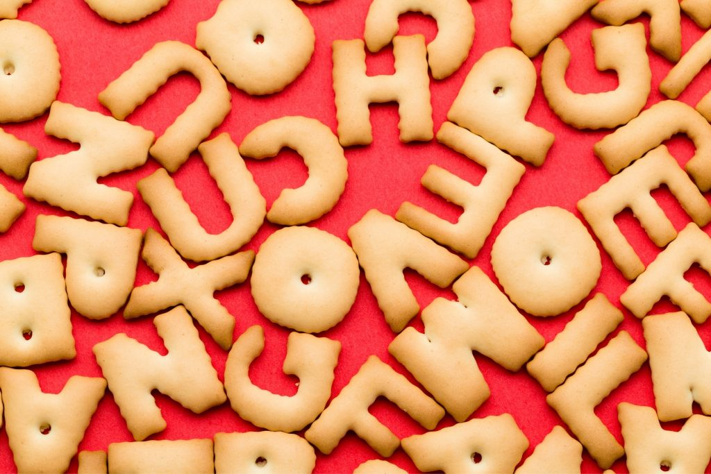 Letter-shaped crackers against a red background