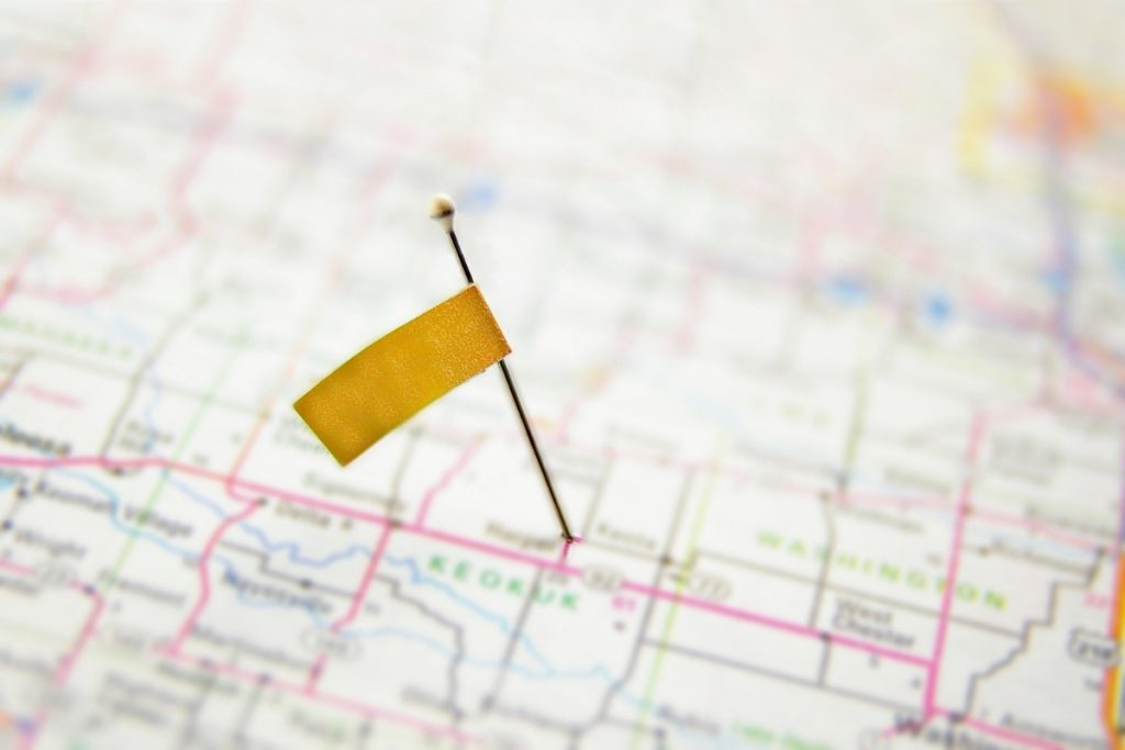 Pin with a yellow flag marking location on a map